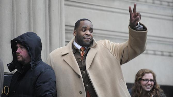 Former Mayor Kwame Kilpatrick waits in line to enter federal court in Detroit on Monday, Jan. 28, 2013. Kilpatrick has been released after spending the weekend in prison for violating parole in a 2008 conviction that booted him from office. Kilpatrick left a Michigan Corrections Department facility in Detroit Monday morning. He had been locked up there since Friday afternoon. He's expected to return Monday to federal court where he's on trial in a separate matter. (AP Photo/The  Detroit News, David Coates) DETROIT FREE PRESS OUT, HUFFINGTON POST OUT, NO MAGS, NO SALES, NO ARCHIVE, MANDATORY CREDIT