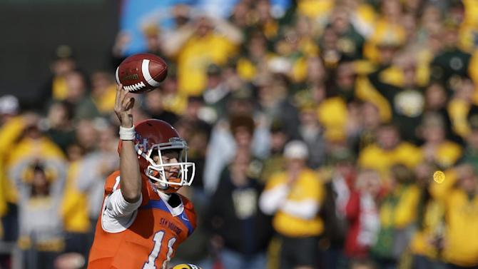 Sam Houston State's Brian Bell (11) gets off a pass as he is hit by North Dakota State's Kyle Emanuel (53) during the second half of the FCS Championship NCAA college football game, Saturday, Jan. 5, 2013, in Frisco, Texas. NDSU won 39-13. (AP Photo/Tony Gutierrez)