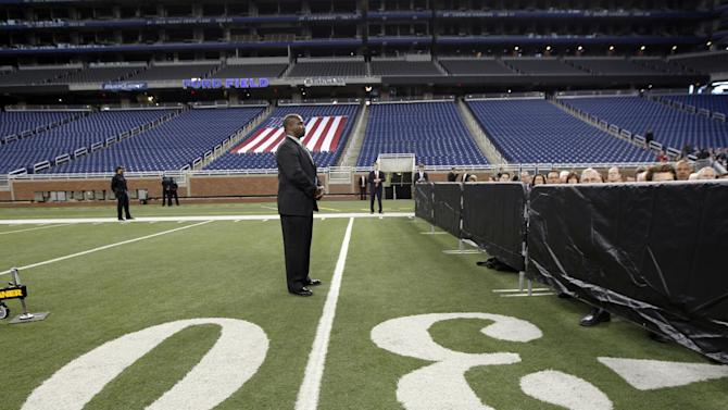 Secret Service agents stand watch as Republican presidential candidate, former Massachusetts Gov. Mitt Romney, not pictured, speaks to the Detroit Economic Club at Ford Field in Detroit, Friday, Feb. 24, 2012. (AP Photo/Gerald Herbert)