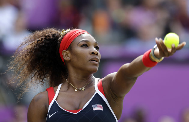 United States' Serena Williams serves to Maria Sharapova of Russia in the women's singles gold medal match at the All England Lawn Tennis Club at Wimbledon, in London, at the 2012 Summer Olympics, Sat
