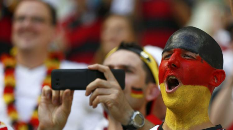 Germany fans wait for the 2014 World Cup Group G soccer match between Germany and Ghana at the Castelao arena