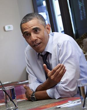 """President Barack Obama has a quiet lunch with a small group of supporters who were winners of his re-election campaign's """"Lunch with Barack"""" fundraising sweepstakes, Friday, Jan. 6, 2012, at a restaurant in Washington.  (AP Photo/J. Scott Applewhite)"""