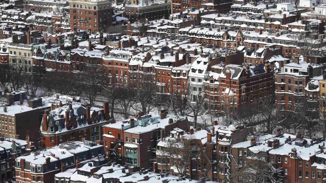 Snow covers roofs and streets following a winter blizzard in Boston