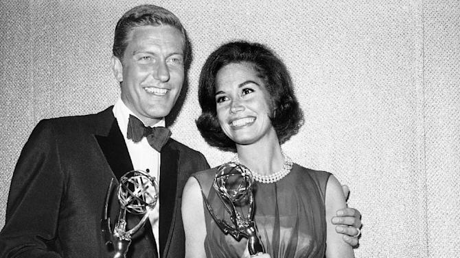 FILE - Dick Van Dyke, left, and Mary Tyler Moore co-stars of The Dick Van Dyke Show pose backstage at the Palladium with the Emmys won in the Television Academy's 16th annual awards show, in Los Angeles, Calif. They won the Emmy Award for best actor and actress in a series. Van Dyke is the recipient of the Life Achievement Award at the upcoming 19th Annual SAG Awards ceremony on Sunday, Jan. 27, 2013. (AP Photo, File)