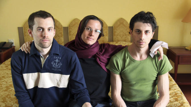 FILE - In this May 20, 2010 file photo, American hikers Shane Bauer, left, Sarah Shourd, center, and Josh Fattal, sit at the Esteghlal Hotel in Tehran, Iran.  Iran has set a Feb. 6, 2011 trial date for three Americans arrested more than a year ago along the Iraqi border and charged with spying, their lawyer said Sunday, Nov. 21, 2010. (AP Photo/Press TV, File)
