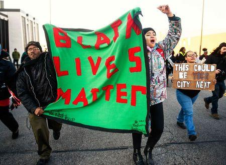Members of the group Black Lives Matter march to city hall during a protest in Minneapolis, Minnesota