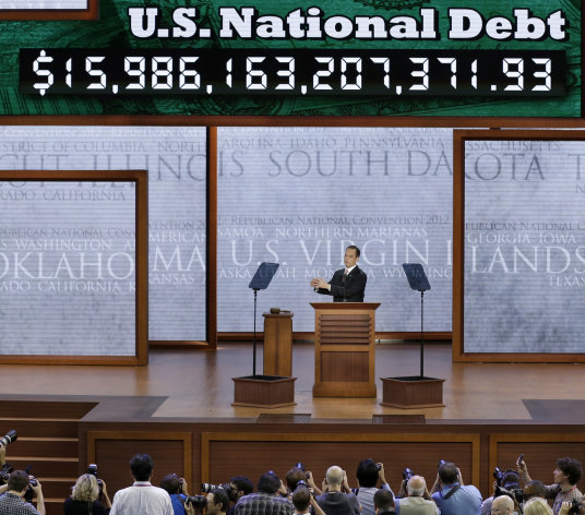Chairman of the Republican National Committee Reince Priebus announces the display of the debt ticker during the Republican National Convention in Tampa, Fla., on Monday, Aug. 27, 2012. (AP Photo/J. Scott Applewhite)