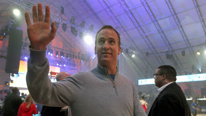 Indianapolis Colts quarterback Peyton Manning waves to the crowd as he arrives for the Celebrity Beach Bowl, part of NFL football's Super Bowl XLVI festivities, Saturday, Feb. 4, 2012, in Indianapolis. †(AP Photo/Jeff Roberson)