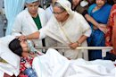 Bangladesh's Prime Minister Sheikh Hasina comforts a garment worker as she visits the survivors of the collapsed Rana Plaza building at a hospital, in Savar