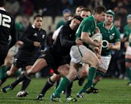 Ireland captain Brian O'Driscoll (R) is tackled by New Zealand's Dan Carter during their rugby union match on June 16. The All Blacks were lucky to defeat Ireland at the death in the second Test, New Zealand pundits and media said Monday