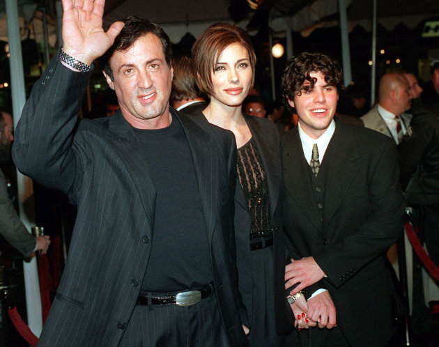 """FILE - In this Dec. 5, 1996 file photo, Sylvester Stallone, left, star of the film """"Daylight,"""" arrives at the film's world premiere with his girlfriend Jennifer Flavin, center, and his son Sage Stallo"""