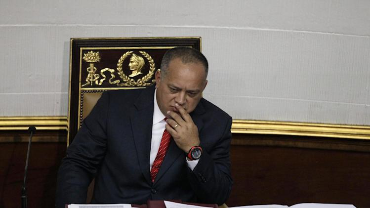 National Assembly President Diosdado Cabello gestures before addressing the National Assembly in Caracas, Venezuela, Saturday, Jan. 5, 2013. Allies of President Hugo Chavez on Saturday chose to keep Cabello as National Assembly president, who is the next in line to step in as a caretaker leader in some circumstances. Opposition leaders have argued that if Chavez doesn't make it back by Jan. 10 to Venezuela from Cuba where he underwent cancer surgery, the president of the National Assembly should take over as interim president.  If Chavez dies or is declared incapacitated, the constitution says that a new election should be called and held within 30 days. Cabello is a longtime Chavez ally who is widely considered to wield influence within the military. (AP Photo/Ariana Cubillos)
