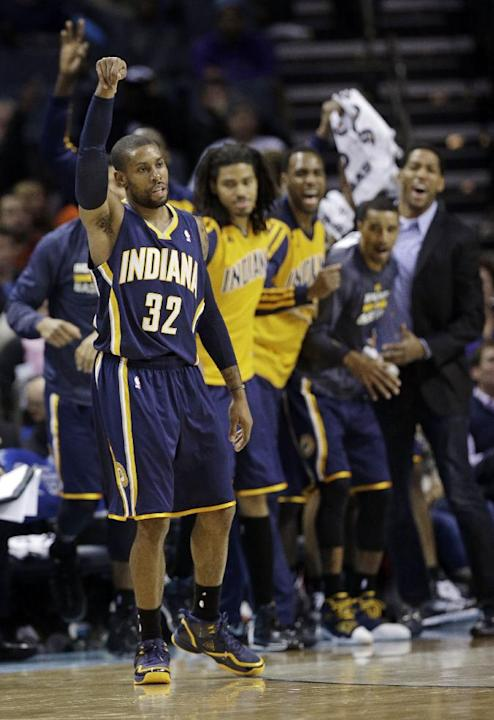 Indiana Pacers' C.J. Watson (32) celebrates after making a 3-point shot against the Charlotte Bobcats during the second half of an NBA basketball game in Charlotte, N.C., Wednesday, Nov. 27, 2013. The