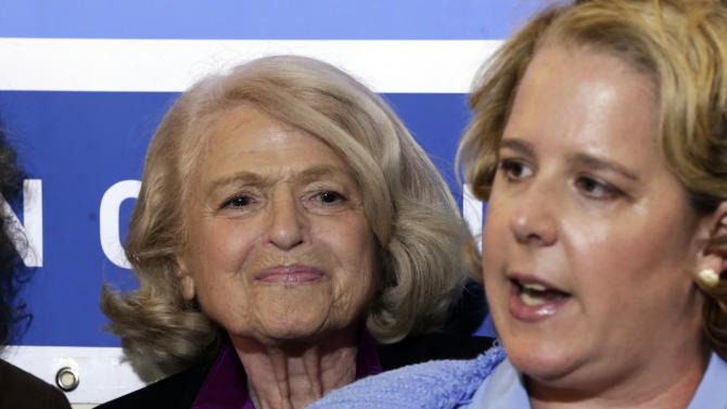 ADDS THAT WINDSOR IS THE PLAINTIFF IN THE HISTORIC GAY MARRIAGE CASE BEFORE THE U.S. SUPREME COURT - Edith Windsor, left, the plaintiff in the historic gay marriage case before the U.S. Supreme Court, smiles as her attorney Roberta Kaplan addresses a news conference at the LGBT Center, in New York, Wednesday, June 26, 2013. In a major victory for gay rights, the U.S. Supreme Court on Wednesday struck down a provision of a federal law denying federal benefits to married gay couples and cleared the way for the resumption of same-sex marriage in California. (AP Photo/Richard Drew)
