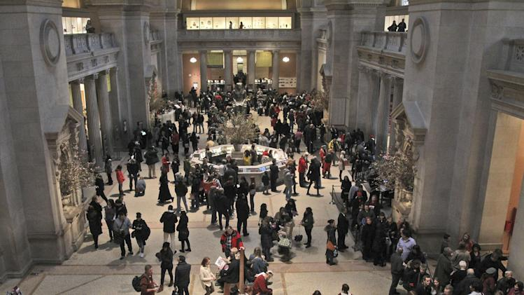 In this Tuesday, March 19, 2013 photo visitors to the Metropolitan Museum of Art in New York congregate in the main lobby. (AP Photo/Mary Altaffer)