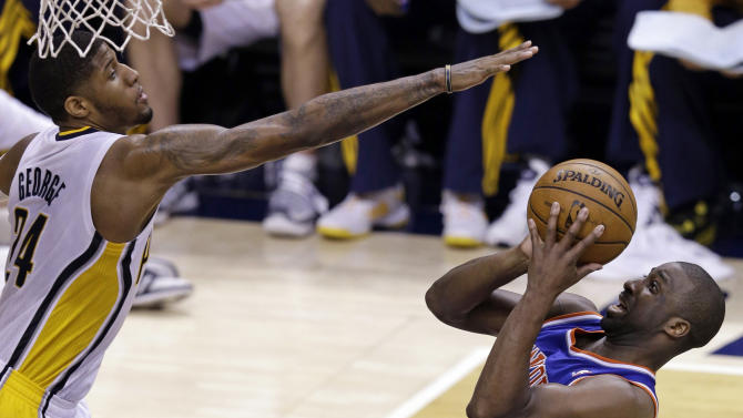 New York Knicks guard Raymond Felton, right, shoots under Indiana Pacers forward Paul George during the third quarter of Game 6 of the Eastern Conference semifinal NBA basketball playoff series in Indianapolis, Saturday, May 18, 2013. (AP Photo/Michael Conroy)