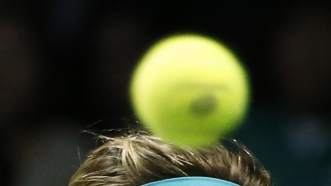 Eugenie Bouchard of Canada eyes ball during her WTA Finals singles tennis match against Ana Ivanovic of Serbia at the Singapore Indoor Stadium