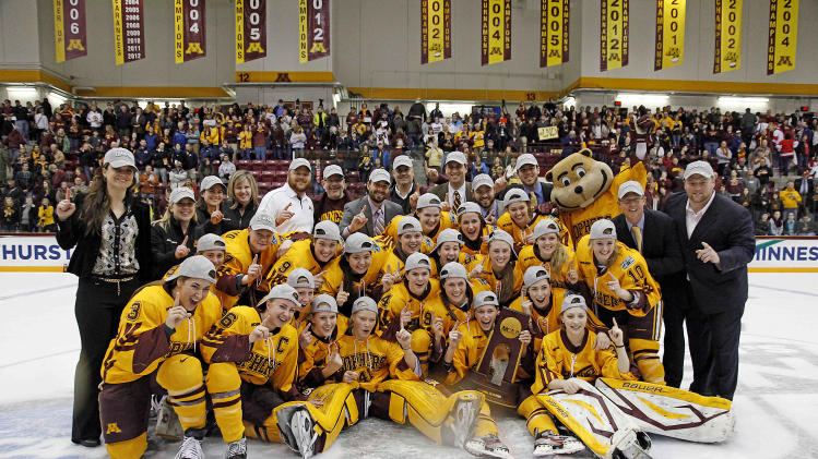 The Minnesota women's hockey team poses with their trophy after their 6-3 win against Boston University in the Frozen Four NCAA Championship college hockey game, Sunday, March 24, 2013, in Minneapolis. (AP Photo/Stacy Bengs)