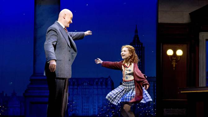 """This theater image released by Boneau/Bryan-Brown shows Anthony Warlow as Daddy Warbucks, left, with Lilla Crawford in the title role of the musical """"Annie,"""" in New York. (AP Photo/Boneau/Bryan-Brown, Joan Marcus)"""