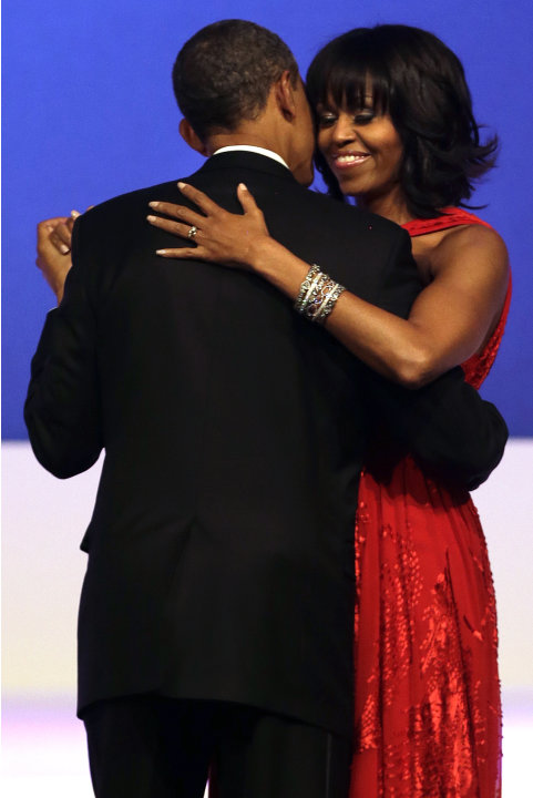 President Barack Obama and first lady Michelle Obama dance together at the Commander-in-Chief Inaugural Ball in Washington, at the Washington Convention Center during the 57th Presidential Inauguratio