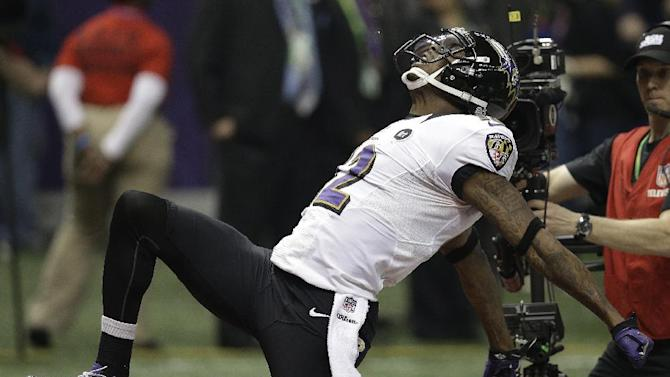 Baltimore Ravens wide receiver Jacoby Jones (12) celebrates after returning a kickoff for a 108-yard touchdown against the San Francisco 49ers during the second half of the NFL Super Bowl XLVII football game, Sunday, Feb. 3, 2013, in New Orleans.(AP Photo/Elaine Thompson)