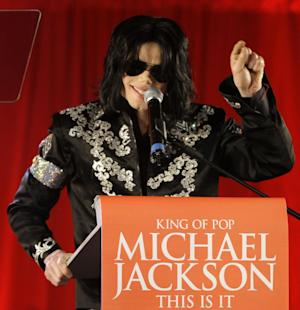 "FILE - In this March 5, 2009 file photo, Michael Jackson announces several concerts at the London O2 Arena in July, at a press conference at the London O2 Arena. An AEG Live accounting executive testified Monday, May 20, 2013, in a Los Angeles courtroom that the company spent $24 million on preparations for Jackson's ill-fated ""This Is It"" shows, however never paid the singer's personal doctor convicted of involuntary manslaughter because a fully-signed agreement was never obtained.  (AP Photo/Joel Ryan, file)"