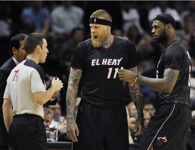 Miami Heat forward Chris Andersen, center, argues with official Kevin Scott, left, as Heat forward LeBron James looks on during the second half of an NBA basketball game against the San Antonio Spurs,
