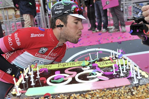 Britain's Mark Cavendish poses with a cake for his birthday before the start of the 16th stage of the Giro d'Italia, Tour of Italy cycling race, from Valloire, France, to Ivrea, Italy, Tuesday, May 21