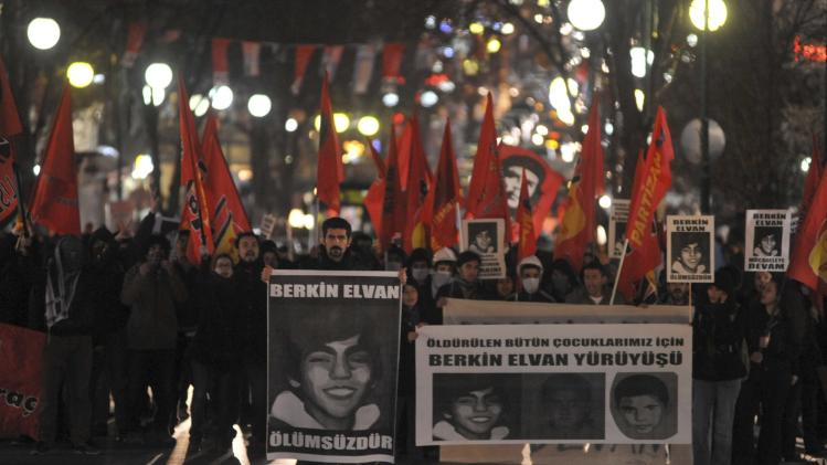 Anti-government protesters march as they carry portraits of Berkin Elvan