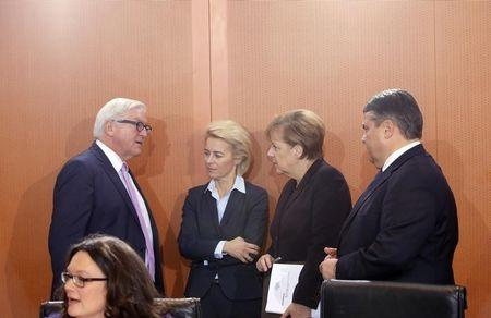 Germany's Foreign Minister Steinmeier, Defence Minister von der Leyen, Chancellor Merkel, Economy Minister Gabriel and Head of the Federal Chancellery Altmeier speak during the weekly cabinet meeting at the Chancellery in Berlin