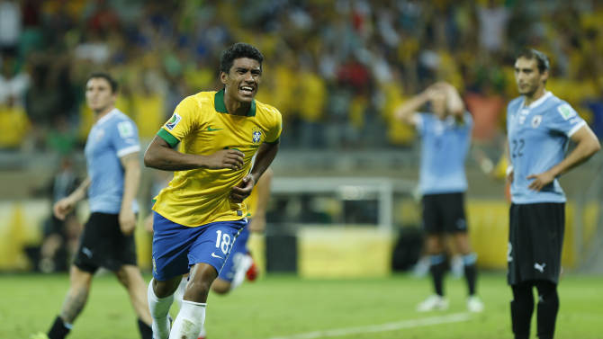 Brazil's Paulinho, second left, celebrates scoring his side's 2nd goal during the soccer Confederations Cup semifinal match between Brazil and Uruguay at the Mineirao stadium in Belo Horizonte, Brazil, Wednesday, June 26, 2013. (AP Photo/Bruno Magalhaes)