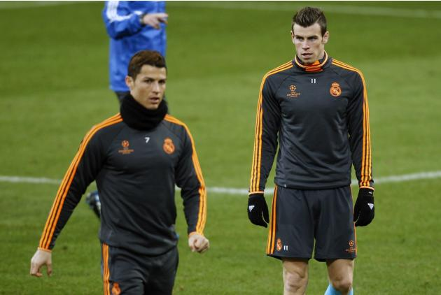 Real Madrid's Cristiano Ronaldo walks past Bale during a training session in Gelsenkirchen