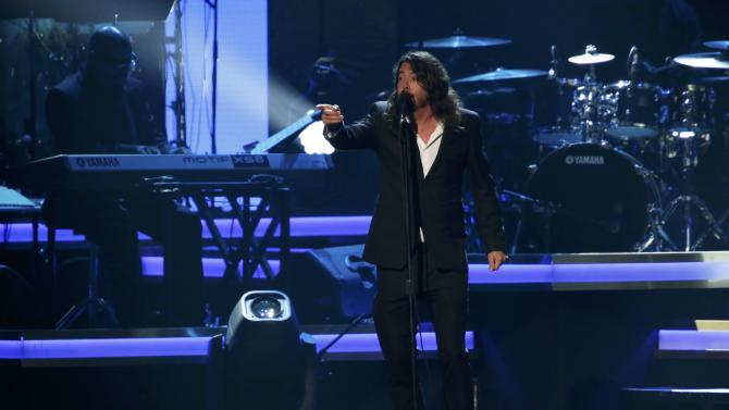 "Musician Dave Grohl performs ""You Are"" at the 2016 MusiCares Person of the Year gala in Los Angeles"