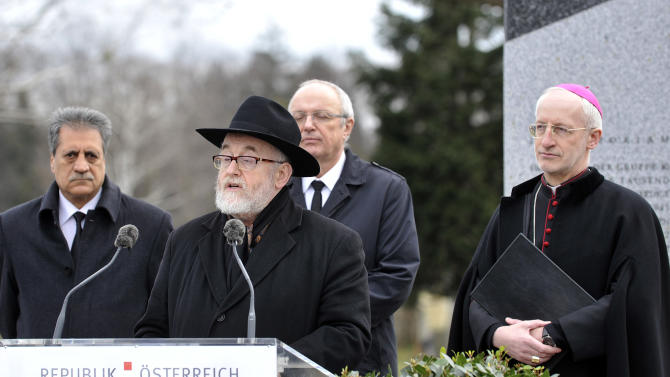 "Chief Rabbi Paul Chaim Eisenberg delivers a speech in front of President of Islamic Community Fuat Sanac, from left, Protestrant Bishop Michael Buenker and Catholic Bishop Franz Scharl during the unveiling of a plaque honoring the thousands of Austrians killed by the Nazis for opposing them, before and after the so-called ""Anschluss"" at the Central Cemetery in Vienna, Austria, Monday, March 11, 2013. (AP Photo/Hans Punz)"
