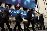 A banner for Pandora Media Inc., the online-radio company, hangs in front of the New York Stock Exchange in 2011. A push to lower music royalties paid by Internet radio has created political disharmony in Washington