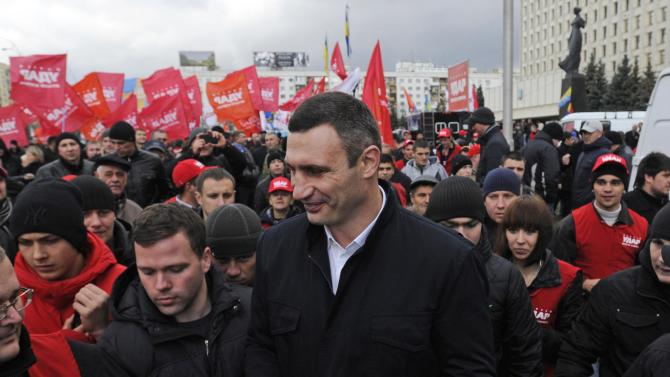 Chairman of the Ukrainian opposition party Udar (Punch) and WBC heavyweight champion boxer Vitali Klitschko , takes part in a rally outside the Central Elections Commission building in Kiev, Ukraine, Tuesday, Nov. 6, 2012. Ukraine's opposition parties are protesting alleged election fraud in last month's parliamentary election.(AP Photo/Sergei Chuzavkov)