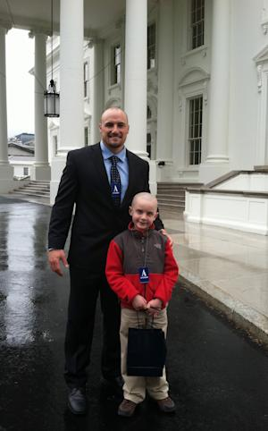This photo provided by Andy Hoffman shows his son Jack with former Nebraska football player Rex Burkhead after meeting with President Barack Obama in Washington, Monday, April 29, 2013. The 7-year-old, who is fighting brain cancer, attracted millions of fans after his 69-yard touchdown run during Nebraska's spring football game. (AP Photo/Courtesy Jack Hoffman)