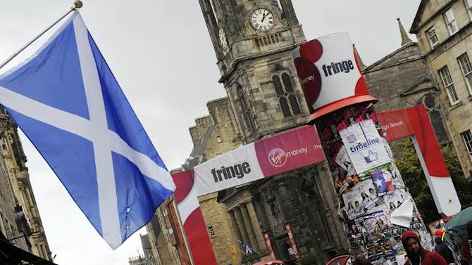 The Scottish Saltire hangs in Edinburgh during the annual Festival Fringe, on August 21, 2013