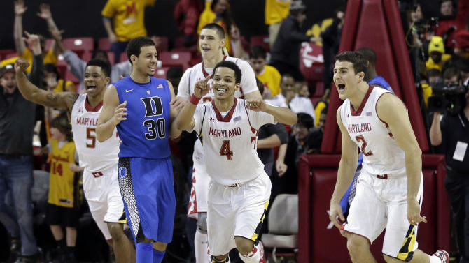 Maryland's Nick Faust (5), Seth Allen (4) and Logan Aronhalt (2) celebrate in front of Duke guard Seth Curry after beating Duke 83-81 in an NCAA college basketball game in College Park, Md., Saturday, Feb. 16, 2013. (AP Photo/Patrick Semansky)