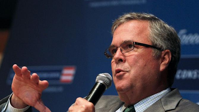 Former Florida Gov. Jeb Bush gestures while speaking at a news conference, Thursday, Dec. 6, 2012, in Philadelphia, where it was  announced he will follow Bill Clinton as chairman of the National Constitution Center. (AP Photo/ Joseph Kaczmarek)