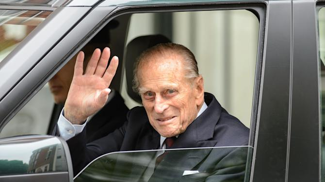 Britain's Prince Philip waves as he leaves the London Clinic in central London, Monday June 17, 2013. The husband of Queen Elizabeth II, who turned 92 last week walked out of a London hospital, 10 days after undergoing exploratory surgery on his abdomen. (AP Photo/PA, Dominic Lipinski) UNITED KINGDOM OUT NO SALES NO ARCHIVE