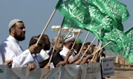 "Arab-Israeli Muslim men wave green Islamic flags with the Muslim profession of belief: ""There is no God but God and Mohammed is the prophet of God"" during a protest in front of the US embassy in the Mediterranean coastal city of Tel Aviv"