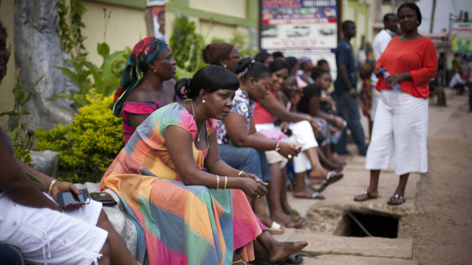 Voters sit and wait three hours after biometric identification machines had broken down, halting voting at a polling station, in Accra, Ghana, Friday, Dec. 7, 2012. Ghanaians went to the polls Friday to choose between four candidates, including President John Dramani Mahama, who inherited the top post in July after President John Atta Mills died in office, and Nana Akufo-Addo, who lost the presidency by less than one percent to Mills in 2008. With its coup era over and five peaceful elections under its belt, Ghana is expected to hold a peaceful poll as voters decide which candidate will ensure the country's new-found wealth reaches the poor and middle-class. (AP Photo/Gabriela Barnuevo)