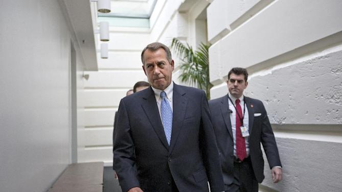 """FILE - In this Dec. 5, 2012, file photo, House Speaker John Boehner of Ohio walks to a closed-door Republican strategy session, Wednesday, Dec. 5, 2012, on Capitol Hill in Washington. Boehner has been caught up in a monumental struggle over taxes and spending aimed at keeping the country from taking a yearend dive over the """"fiscal cliff."""" President Barack Obama is tugging Boehner one way in pursuit of a budget deal, while conservatives yank the other way, some howling that the speaker already is going wobbly on them and turning vindictive against those in his party who dare disagree.  (AP Photo/J. Scott Applewhite, File)"""