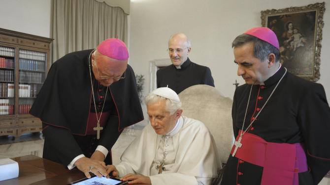 "FILE - In this June 28, 2011 file photo, Pope Benedict XVI touches a touchpad to send a tweet for the launch of the Vatican news information portal ""www.news.va"", at the Vatican. The Vatican said Monday, Dec. 3, 2012, that Pope Benedict XVI will start tweeting in six languages from his own personal handle (at)Pontifex, on Dec. 12. The pontiff will be using a question and answer format in his first Tweet, focusing on answering questions about faith — in 140 characters. (AP Photo/Osservatore Romano, File) EDITORIAL USE ONLY"