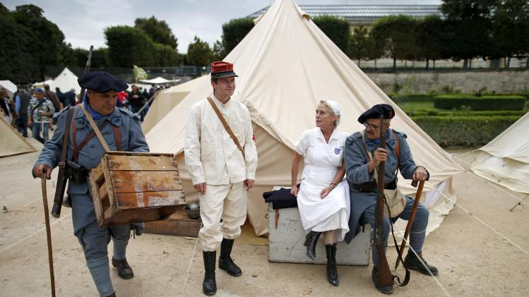 People dressed in French WWI military uniforms take part in a military camp reconstitution in the Tuileries Garden in Paris