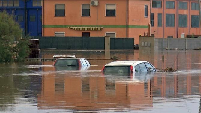 Submerged cars are seen on a flooded street in San Gavino Monreale on Sardina island