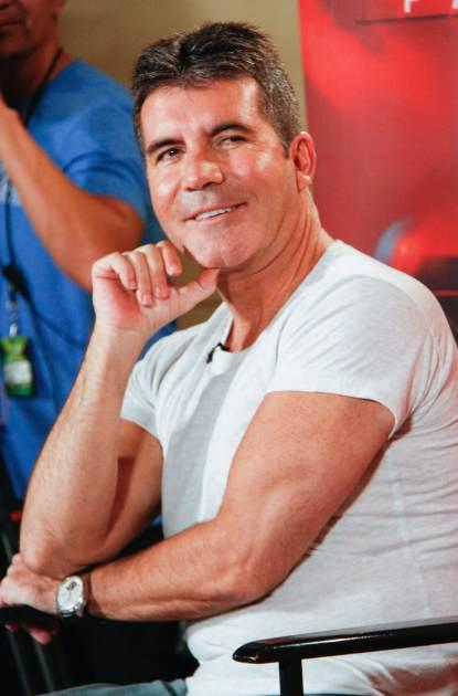 Simon Cowell attends the 'The X Factor' Judges press conference at Nassau Veterans Memorial Coliseum on June 20, 2013 in Uniondale, New York -- Getty Images