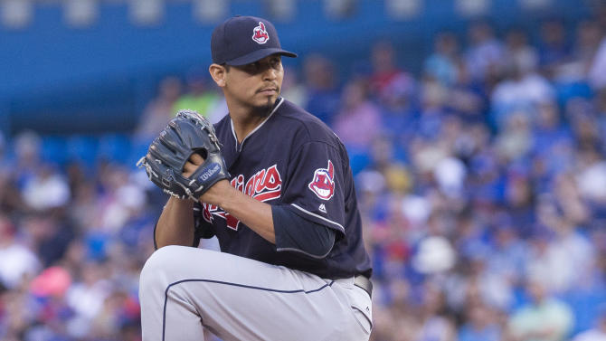 Cleveland Indians starting pitcher Carlos Carrasco winds up during the first inning of a baseball game against the Toronto Blue Jays on Thursday, June 30, 2016, in Toronto. (Chris Young/The Canadian Press via AP)