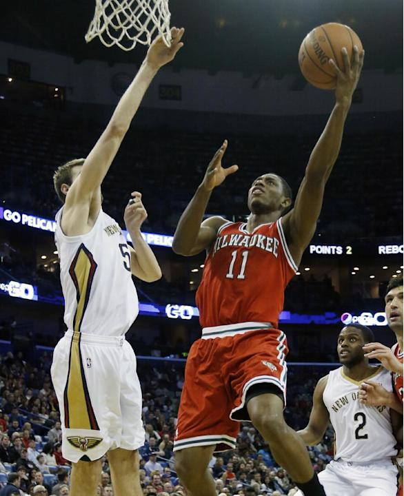 Milwaukee Bucks point guard Brandon Knight (11) against New Orleans Pelicans center Jeff Withey (5) in the first half of an NBA basketball game in New Orleans, Friday, March 7, 2014. (AP Photo/Bill Ha